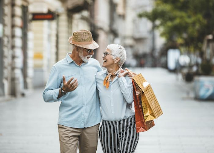 older couple shopping with bags of purchased items